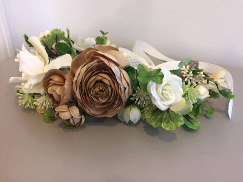 Amelia and Paprika flower halo filled with neutral flowers in tan and creamy white and greenery. Custom made for our shop and adjustable in size due to the tie back ribbons. One size fits most.