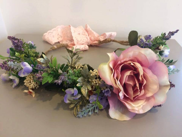 Amelia and Paprika flower halo filled with romantic flowers in dusty pink and soft purples along with greenery. Custom made for our shop and adjustable in size due to the tie back ribbons. One size fits most.