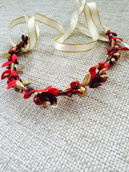 Angelica flower halo with red and gold accents. Tie back ribbons allow for adjustable sizing.