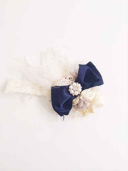 Custom made Avry Couture Creations headband with cream lace and navy blue accents. Elastic band. Fits infant through young girls.