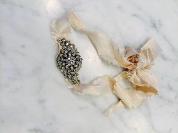 Avry Couture Creations raw silk tie back hair accessory with crystal gem. Stunning piece that takes you to a different era. Perfect for girls and even mom!