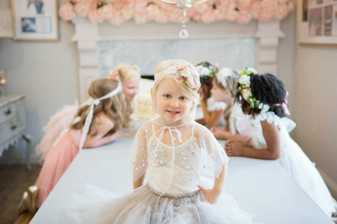 Avry Couture Creations the perfect little headband with light and dark pink accents. Elastic band for adaptable fit.