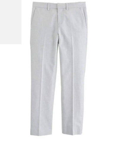 This slim lightweight gray cotton oxford pant has an internal adjustable elastic waistband, belt loops, zip fly, slant pockets in the front, and back welt pockets. These pants are lightweight and breathable and perfect for warmer weather. Available for rent from The Borrowed Boutique.