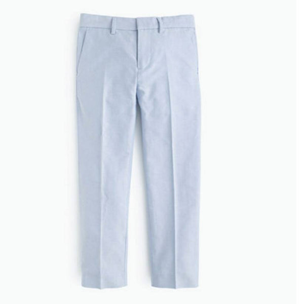 This slim lightweight cotton oxford suit pant has an internal adjustable elastic waistband, belt loops, zip fly, slant pockets in the front, and back welt pockets. These pants are lightweight and breathable and perfect for warmer weather. Available for rent from The Borrowed Boutique.