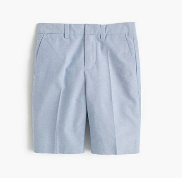 This slim lightweight cotton oxford suit short in retro blue has an internal adjustable elastic waistband, belt loops, zip fly, slant pockets in the front, and back welt pockets. These shorts are lightweight and breathable and perfect for warmer weather. Available for rent from The Borrowed Boutique.