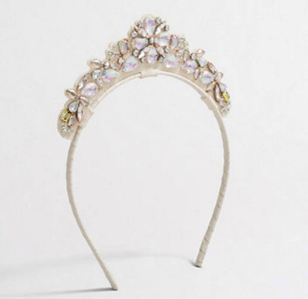 Our beautiful crystal sparkles iridescent tiara makes for the most amazing hair accessory. One size fist most. Available for rent from The Borrowed Boutique.
