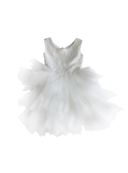 DOLLY by Le Petit Tom ®  the PIROUETTE DRESS in White. A beautiful dress made of soft lace, satin and tulle. Available for rent from The Borrowed Boutique.