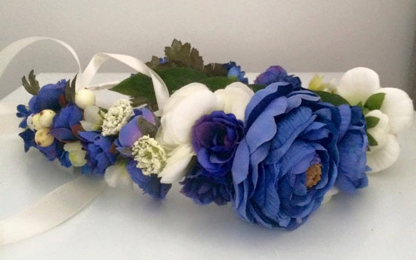 This custom blue, white, and greenery custom floral halo makes the most perfect hair accessory. One size fits most. Available for rent from The Borrowed Boutique.