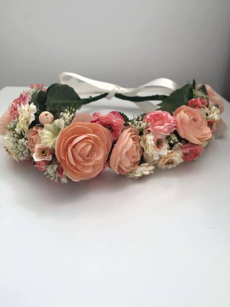 This custom blushing flower girl peach, pink, and cream floral halo makes for the most perfect hair accessory. One size fits most. Available for rent from The Borrowed Boutique.