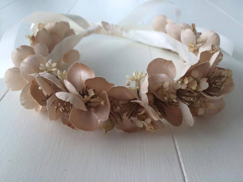 This champagne and gold custom floral halo makes for the perfect hair accessory. One size fits most. Available for rent from The Borrowed Boutique.