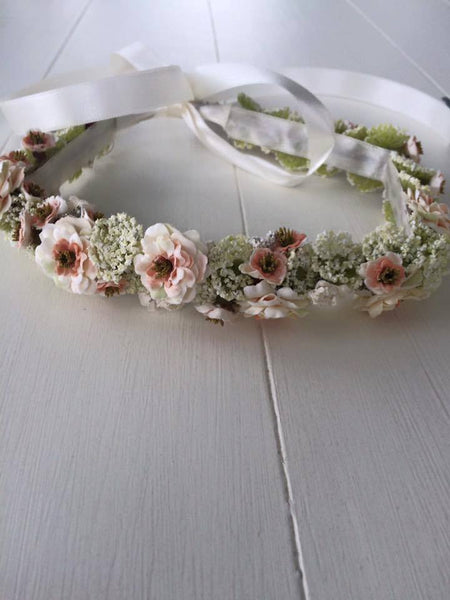 Custom fairy's breath cream, peach, and pink floral halo. One size fits most. Available for rent from The Borrowed Boutique.