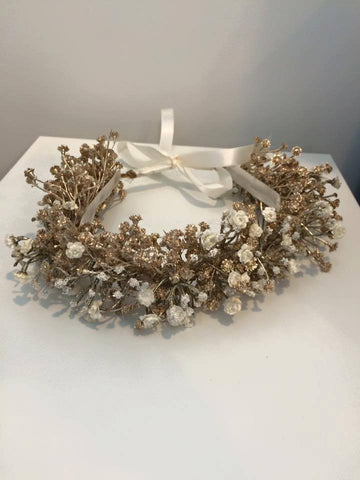 Our custom gold and cream angel petal floral halo makes for a perfect hair accessory. One size fits most. Available for rent from The Borrowed Boutique.