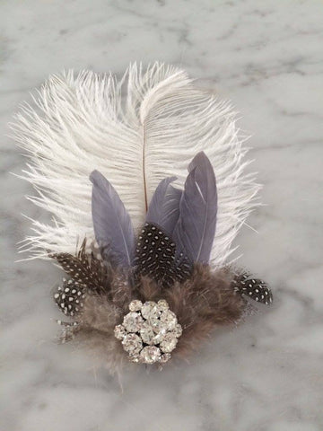 Our custom grey and white feather hair clip makes for an amazing hair accessory. One size fits most. Available for rent from The Borrowed Boutique.