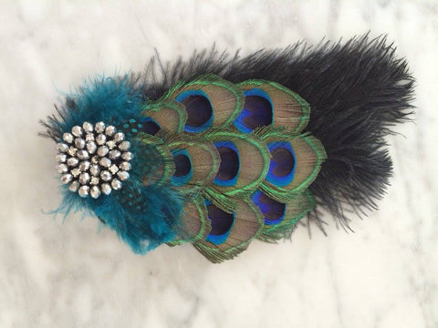 This amazing custom peacock feather hair clip makes for an amazing hair accessory. One size fits most. Available for rent from The Borrowed Boutique.
