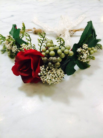 Our custom red, green, and cream custom floral halo makes an amazing hair accessory. One size fits most. Available for rent from The Borrowed Boutique.