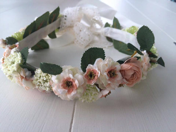 Our custom small princess bride cream, peach, and pink with greenery floral halo makes an amazing hair accessory. One size fits most. Available for rent from The Borrowed Boutique.