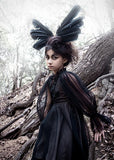 Little girl wearing the Tutu Du Monde Raven Wings Dress In Black from The Borrowed Boutique.