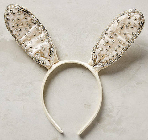 Amazing headpiece for that special occasion and/or photo shoot. Glitter studded cream bunny ears. One size fits most. Available for rent from The Borrowed Boutique.