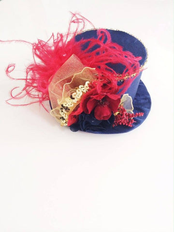 Little Lady Accessories Ring Master Blue, Gold, and Red Mini Top Hat available for rent from The Borrowed Boutique.