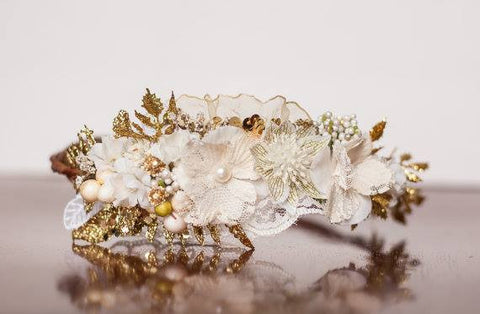 Little Lady Accessories White and Gold Ella Floral Halo available for rent from The Borrowed Boutique.