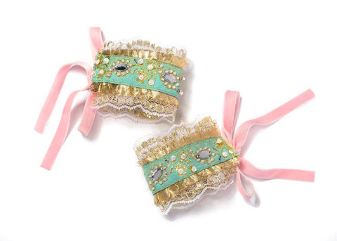 Modern Queen Kids Chandelier Cuffs in Gold, Seafoam, and Pink available for rent from The Borrowed Boutique.