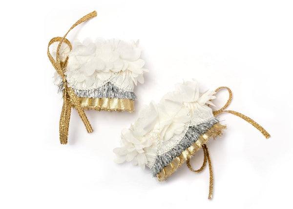 Modern Queen Kids Ruffled Cuffs in Ivory, Gold, and Silver available for rent from The Borrowed Boutique.