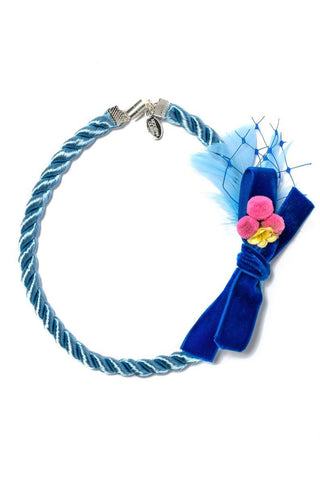 Modern Queen Kids Spring Corsage Necklace in Blue available for rent from The Borrowed Boutique.