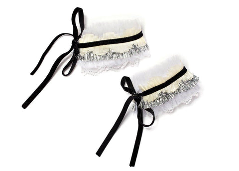 Modern Queen Kids Tulle Party Cuffs in Ivory, Silver, and Black available for rent from The Borrowed Boutique.