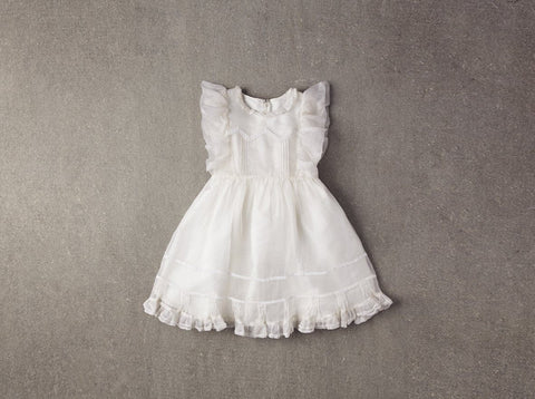 Nellystella Flora Dress in White available for rent from The Borrowed Boutique.