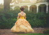 Back view of Prima Fashions Beauty and The Beast Belle Gown in Yellow available for rent from The Borrowed Boutique.