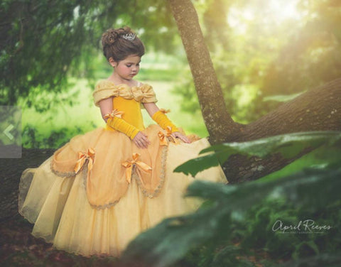 Prima Fashions Beauty and The Beast Belle Gown in Yellow available for rent from The Borrowed Boutique.