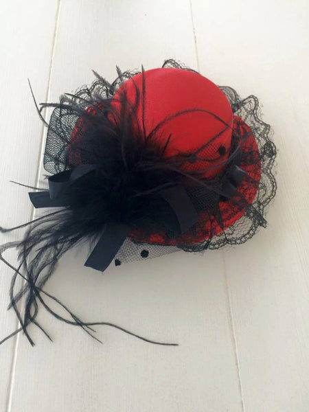 Red and Black Mini Clip-On Hat available for rent from The Borrowed Boutique.