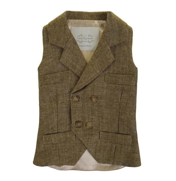 Little Wardrobe London Herringbone Boys Double Breasted Waistcoat In Bronze. Available for rent from The Borrowed Boutique.