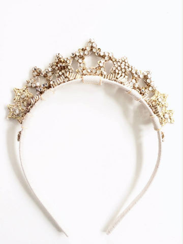 Stunning gold star tiara headband. One size fits most. Available for rent from The Borrowed Boutique.
