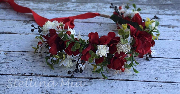 Stellina Mia Snow White Red, Green, and Cream Floral Halo available for rent from The Borrowed Boutique.