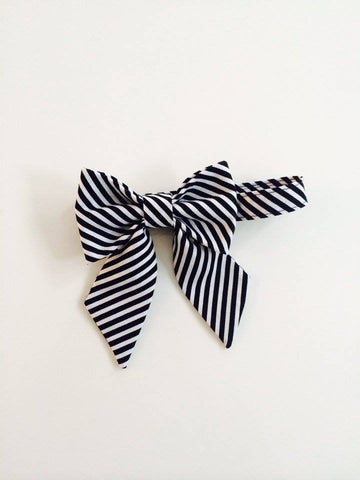 The Posh Society Damsel Bow Tie in Black and White available for rent from The Borrowed Boutique.