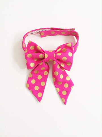 The Posh Society Damsel Bow Tie in Pink and Gold Polka Dot available for rent from The Borrowed Boutique.