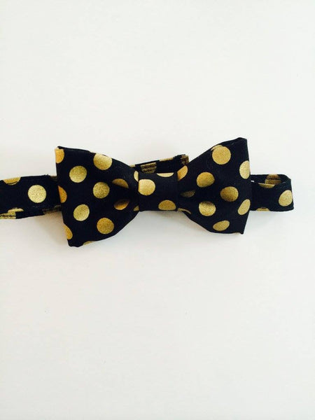 The Posh Society Holiday Dapper Bow Tie With Metallic Gold and Black Circles available for rent from The Borrowed Boutique.