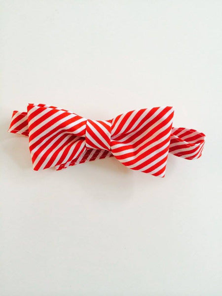 The Posh Society Red and White Striped Dapper Bow Tie available for rent from The Borrowed Boutique.