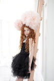 Young girl wearing the Tutu Du Monde Possibility Tutu Dress in Black available for rent from The Borrowed Boutique.