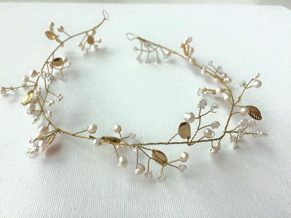 The Posh Society Gold Leaf Tiara available for rent from The Borrowed Boutique.