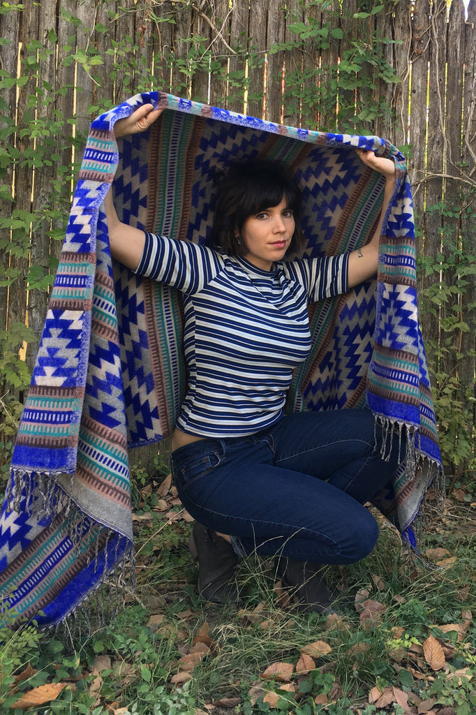 Modeling Mucho Merch-Southwest Style Chal in Blue Aztec