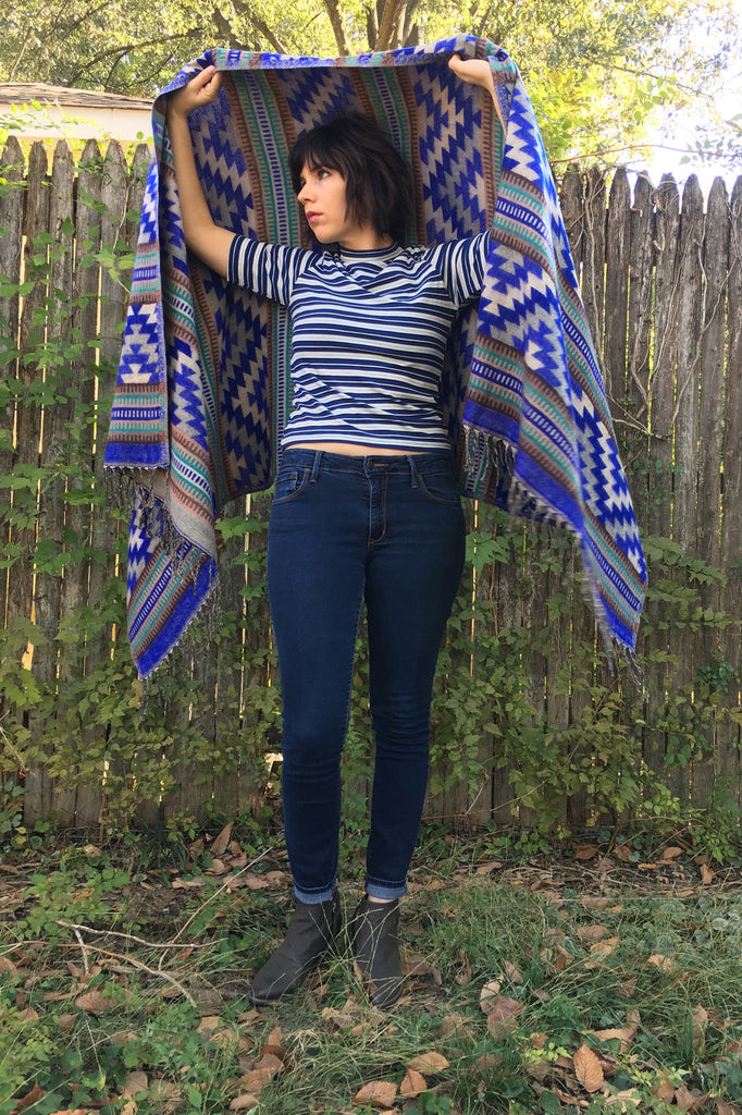 ShopMucho owner models womens accessory Southwest style shawl in blue aztec