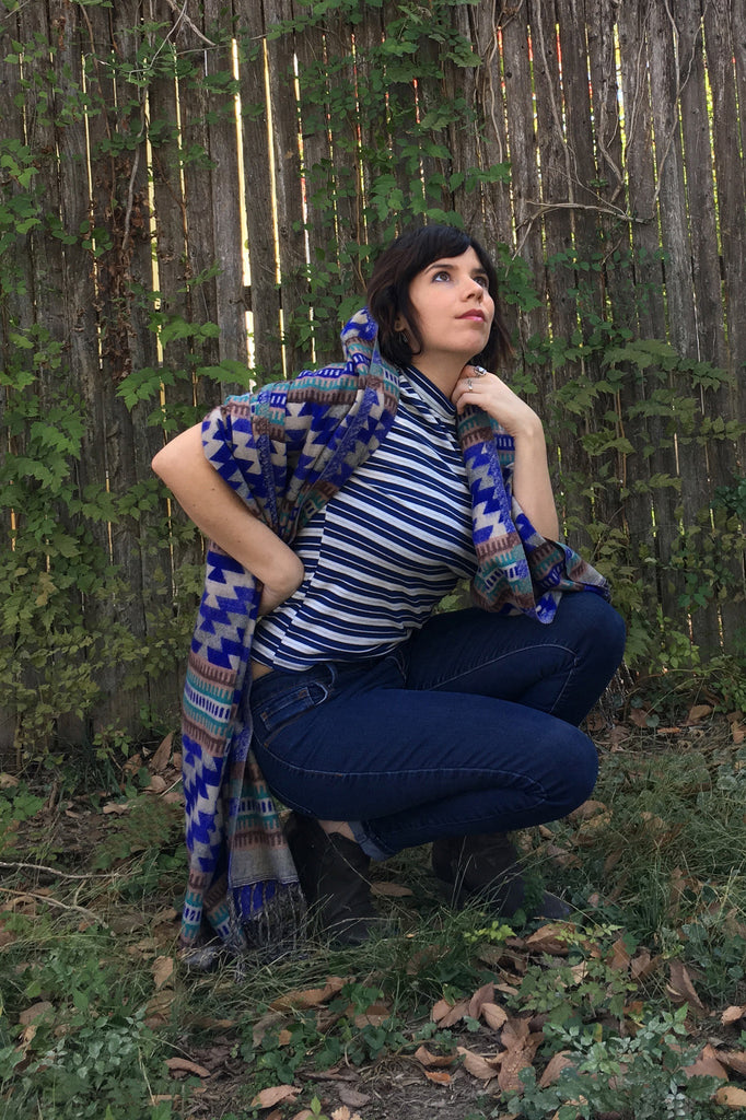 ShopMucho owner models Mexican clothing Southwest style shawl in blue aztec
