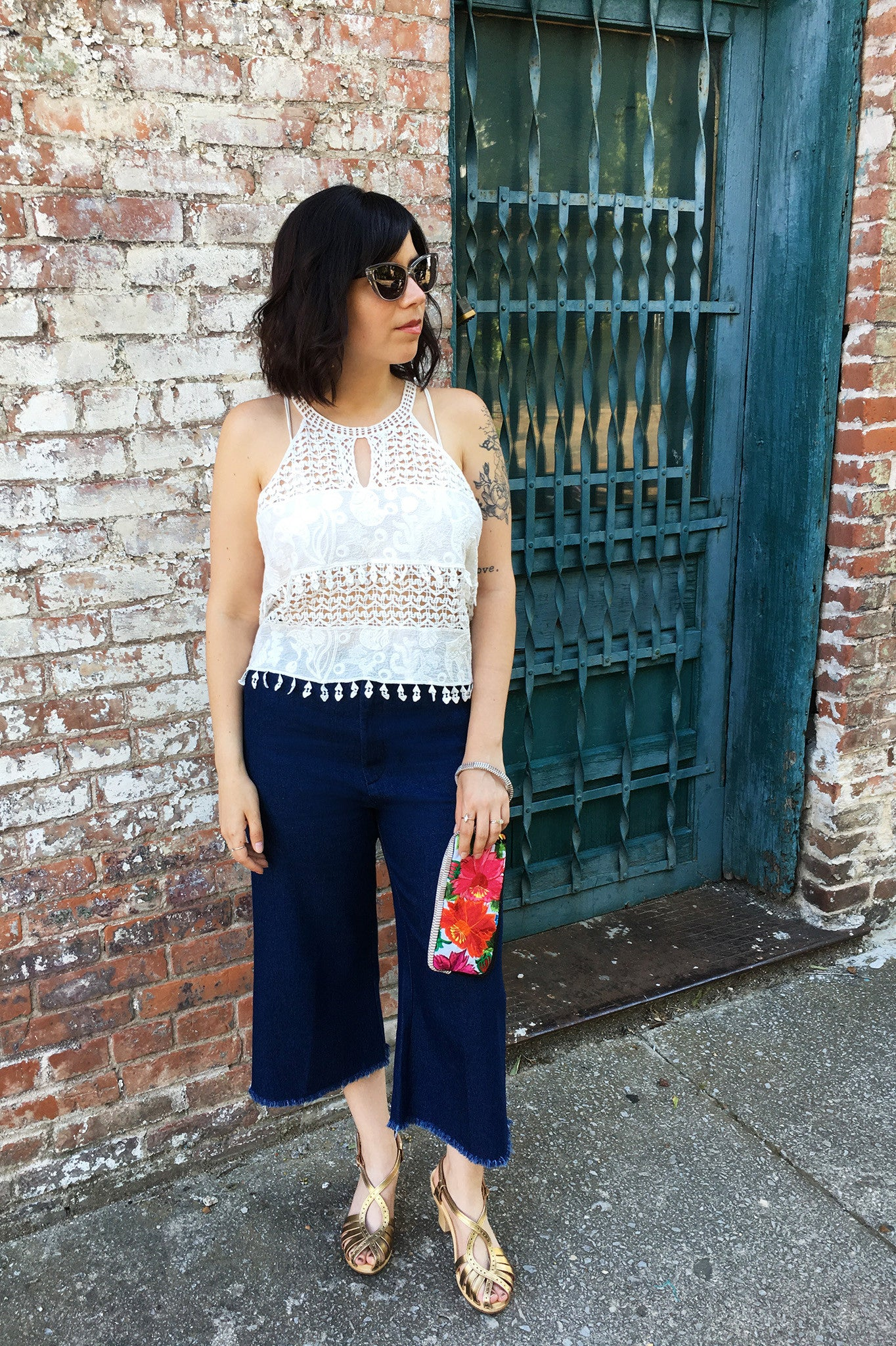ShopMucho owner style an outfit for a summer evening out downtown in crochet crop top and crop denim frayed denim pants
