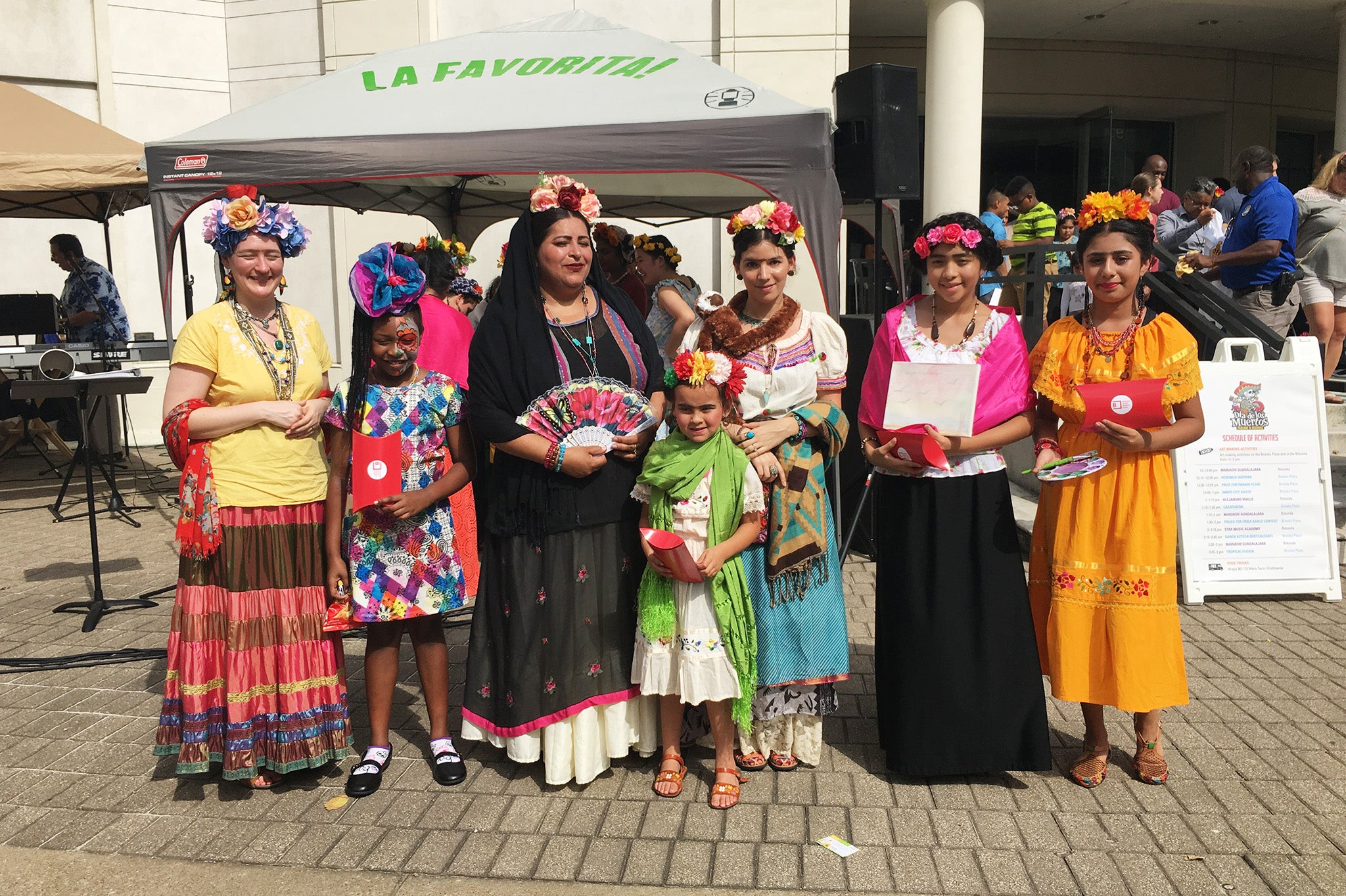 ShopMucho owner dresses as Frida Kahlo and attends the Day of the Dead festival, parade, and Frida Kahlo look a like contest