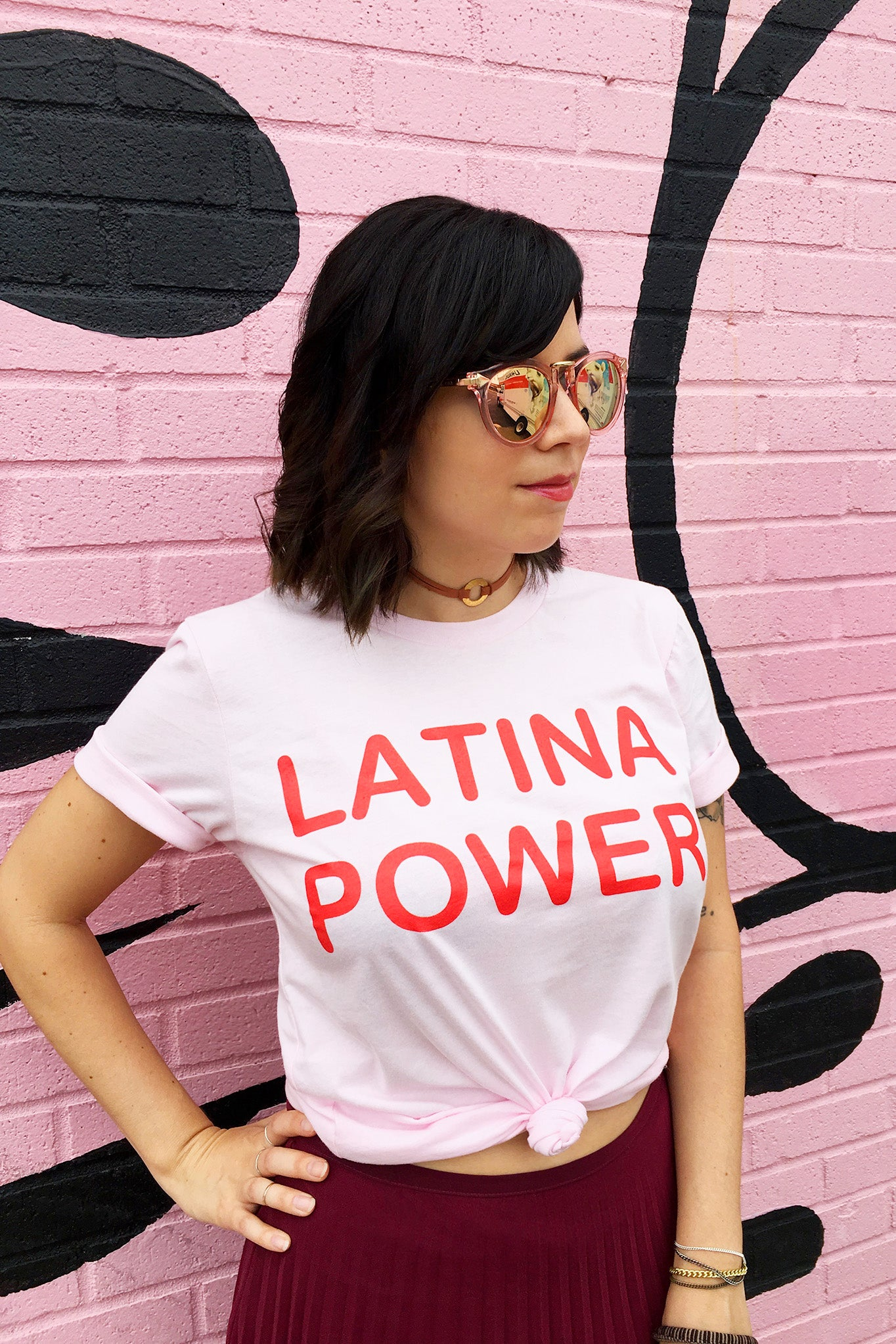 ShopMucho owner styles the Latina Power graphic tee on the blog