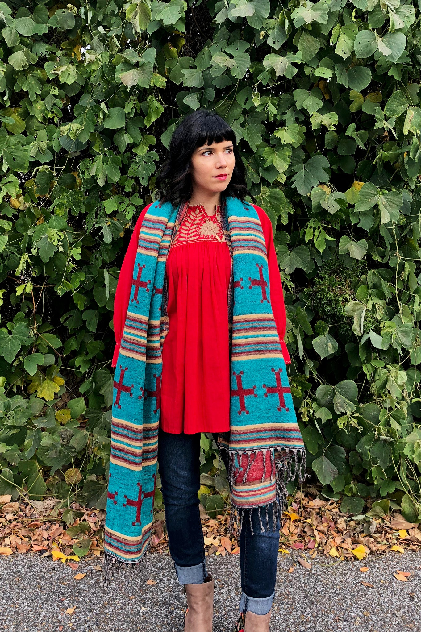 ShopMucho owner styles ways to wear the southwest style shawl with the Mexican blouse and skinny jeans
