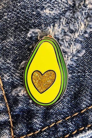 ShopMucho avocado enamel pin with a glitter heart