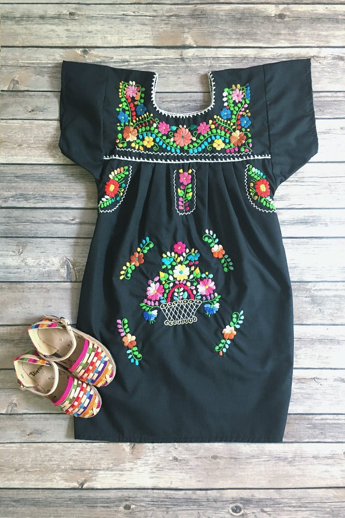 30fcc952349 ... ShopMucho little girls Mexican dress embroidered with colorful flowers  in black flatlay ...